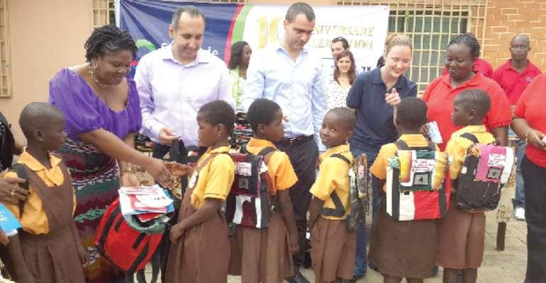 Finatrade presents items to pupils