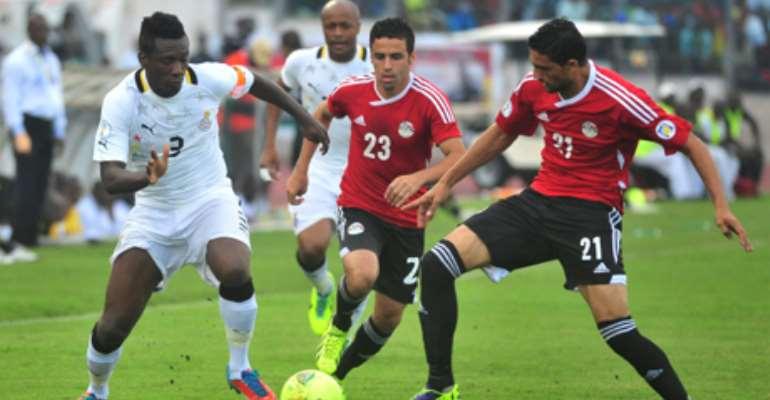 Asamoah Gyan in action for Ghana against Egypt.