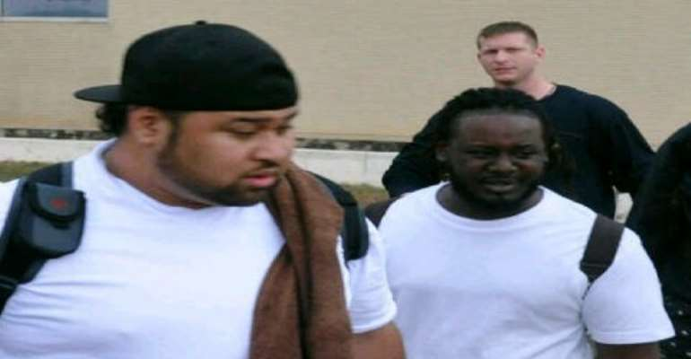 T-Pain(right), minutes after touching down at the Kotoka International Airport