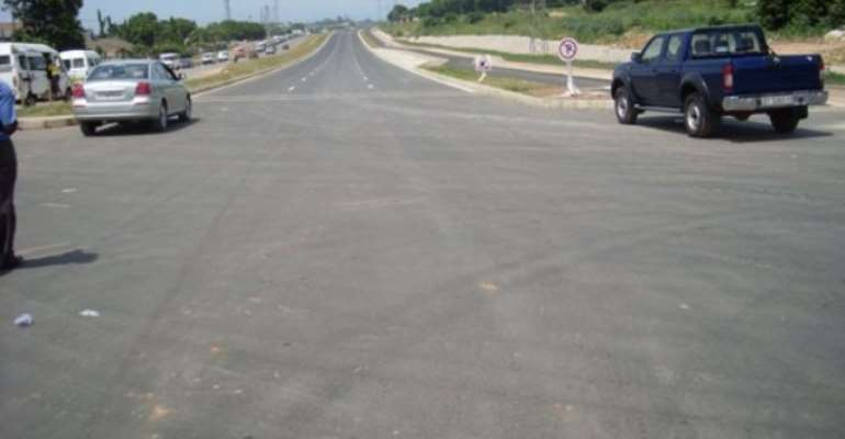 The completed Okponglo stretch of the Tetteh              Quarshie – Madina Road that would be opened to              traffic on Saturday