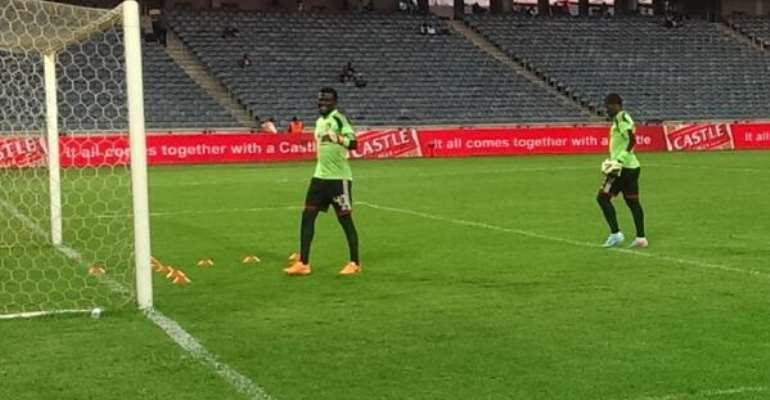 Dauda warming up with Meyiwa ahead of Tuesday's game