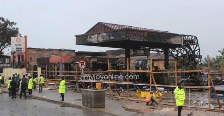 June 3 disaster committee tours tattered Goil Filling Station