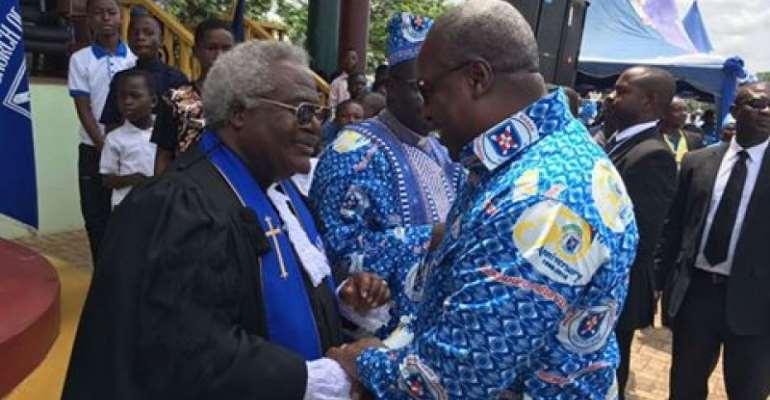 President John Mahama (right) in a handshake with Professor Emmanuel Martey