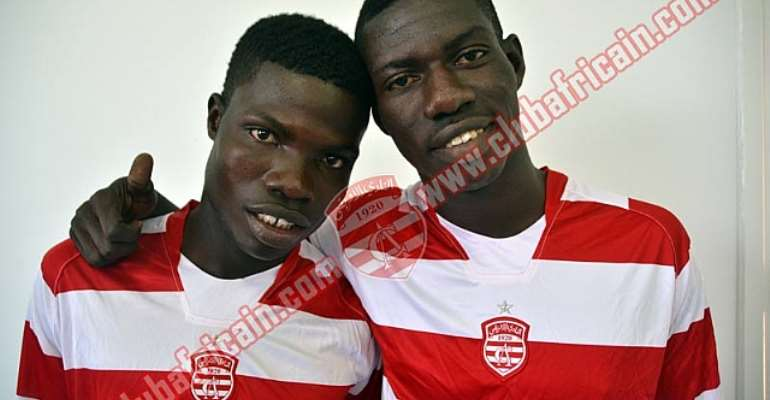 Francis Narh (left) and Derrick Mensah being unveiled by Club Africain