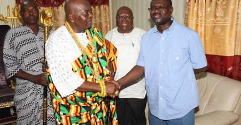 The Awoemefia of Anlo state, Togbui Sri III in a handshake with Mr. Agyepong, looking on are some elders of the Anlo State