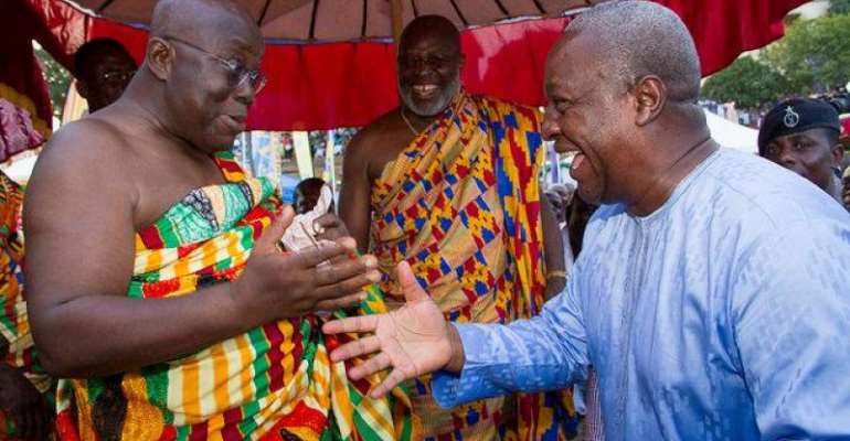 President John Mahama(right) in a handshake with the opposition leader Nana Akufo-Addo (left)