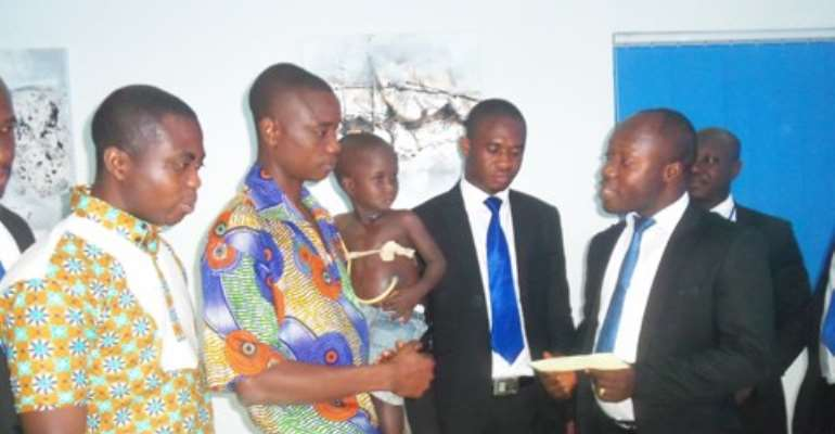 Mr. Owusu-Afriyie presenting the cheque to father of the victim, Razak Anaba.