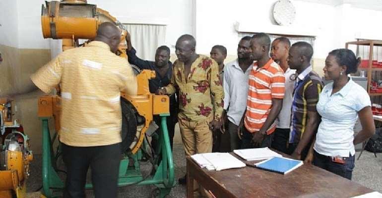 Hon Edward Ennin with Obuasi Apprenticeship students at AGA Engineering Training Centre