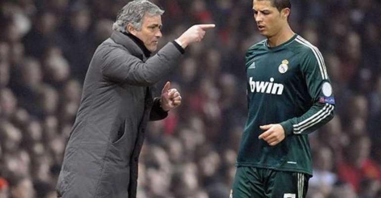 LISTEN UP ... Mourinho talks tactics but Ronaldo is not interested