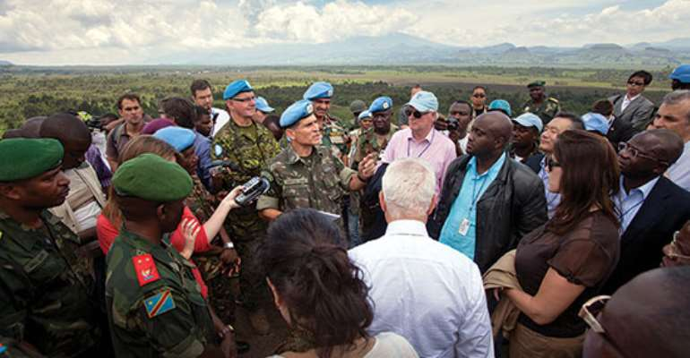 UN Photo/Sylvain Liechti Security Council delegation being briefed during its visit Goma, DRC