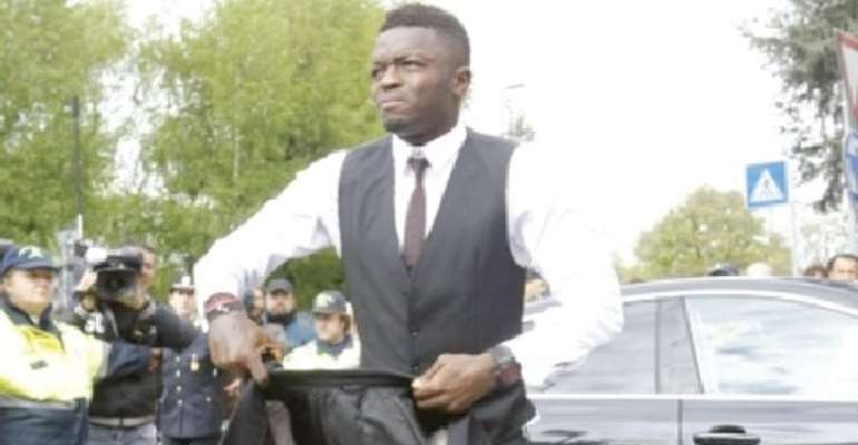 Time for serious business: Sulley Muntari arrives at his office, 4FK MotorSport, where cars are pimped for millionaires and super stars.