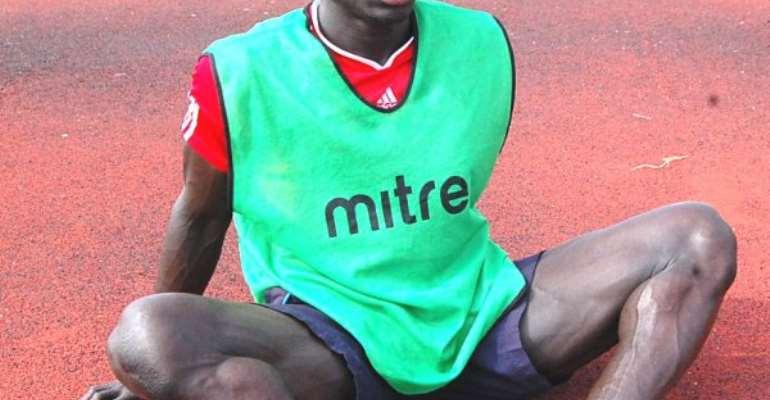Kweku Andoh will miss Hearts' game against Berekum Chelsea