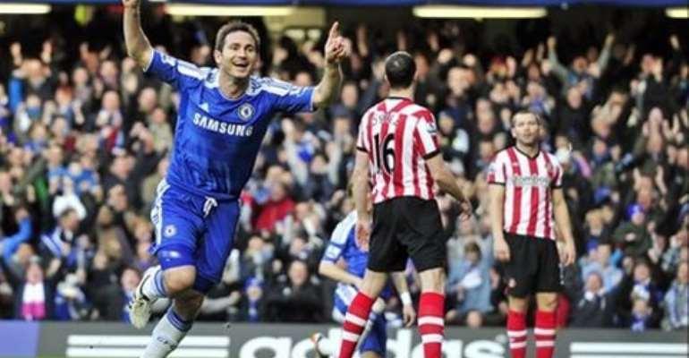 Lampard celebrates his first-half winner - his 11th goal this season