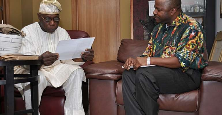 L-R- Former President Olusegun Obasanjo and IITA Director-General, Dr. Nteranya Sanginga, during a courtesy call on the former president in Abeokuta on Monday