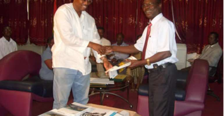 Mr. Attipoe presenting the books to Prof. Mireku Gyimah VC of UMaT