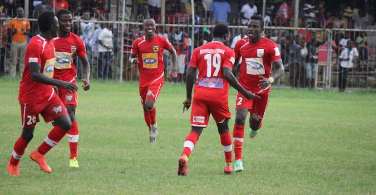 Asante Kotoko players celebrating a goal.