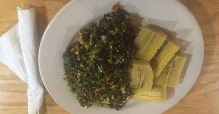 Boiled plantain and green herb stew