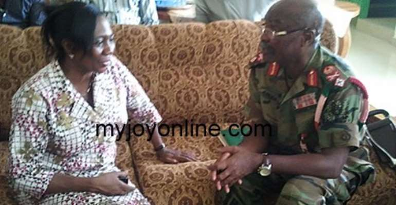 Commandant of the Southern Command Brigadier General Ahiaglo interacting with Hohoe MCE Dr Margret Kweku