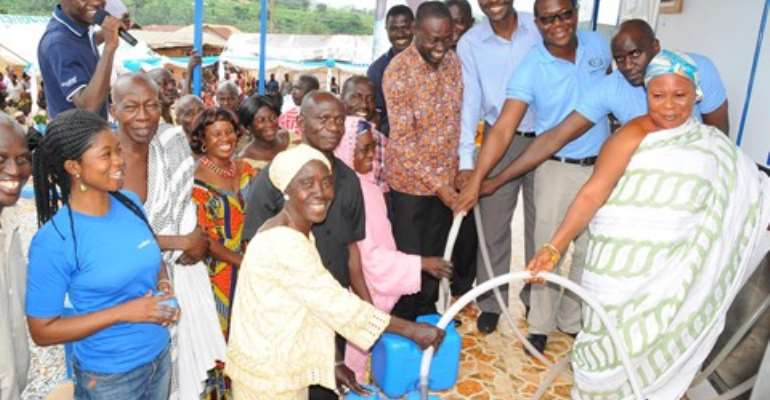 Officials of GGBL and elders of Domeabra fetched the first water at the commissioning ceremony.