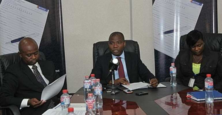 Stephen Abban (middle) Head of Retail Banking addressed the media