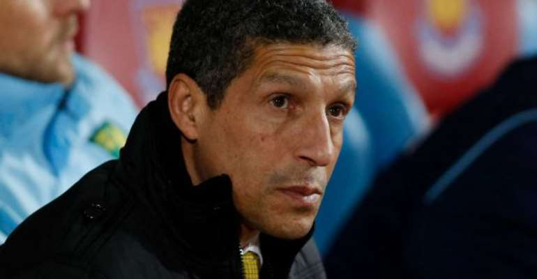 Chris Hughton looks on from the dugout before the start of their English Premier League soccer match against West Ham United at Upton Park, London