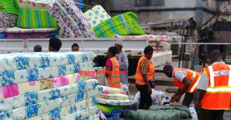 NADMO distributes relief items to flood victims