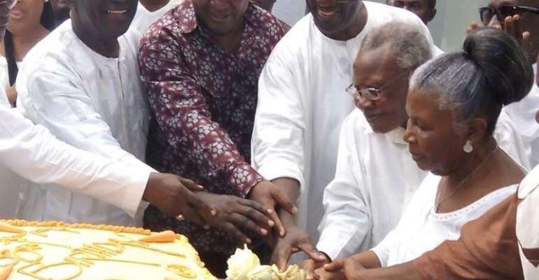 President Mahama helping to cut the birthday cake