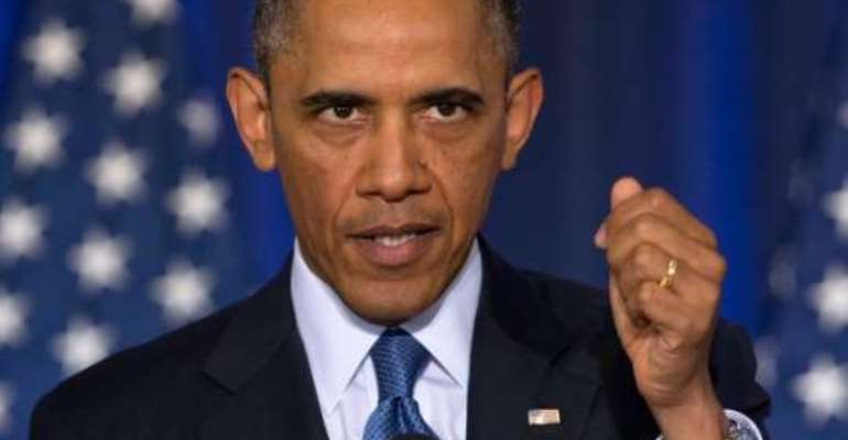 Obama grants clemency to dozens more inmates as part of 'second chance' initiative