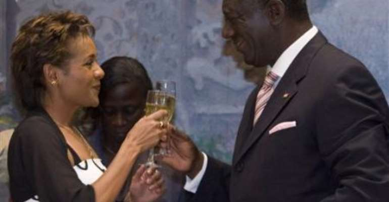 Gov. Gen. of Canada Michaelle Jean, left, shares a toast at a state dinner given in her honor by Ghana President John Agyekum Kufur, right, in Accra, Ghana, Tuesday, Nov. 28, 2006.AP Photo/CP, Fred Chartrand)