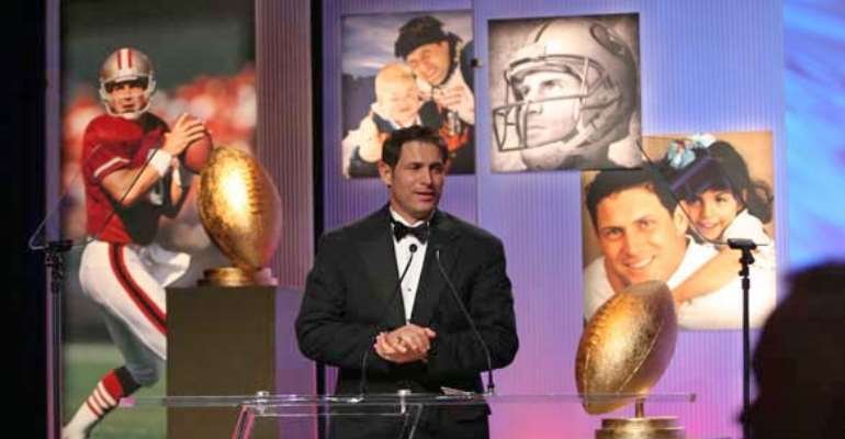Steve Young is honored by the Utah nonprofit Operation Kids, which raised money for his Forever Young group. Photo, 2005, by Mike Olson, Newman Photography