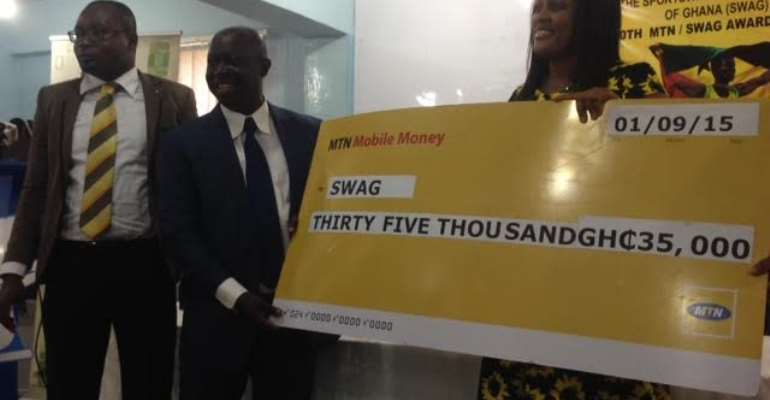 SWAG President Kwabena Yeboah receiving the cash cheque