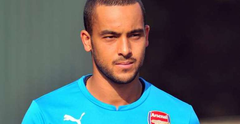 Arsenal winger Theo Walcott is happy to be patient in his recovery from knee surgery