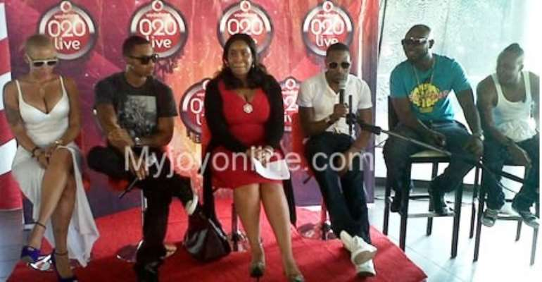 Vodafone Ghana CMO, Uche Ofodile (in red) with US-based R&B star Trey Songs (on michrophone), Amber Rose (far left), Dbanj (second from left) and Ghana own Lazy and Promzy of VIP fame