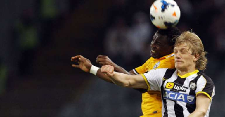 Juventus' Kwadwo Asamoah (L) jumps for the ball with Udinese's Dusan Basta during their Italian Serie A match on Monday.