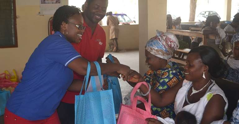 Yaw Ofori Owusu (Airtel Employee And Leader Of The Project) And Ms. Eleanora Agyei Handing Over The New-Born Arrival Packs To Some Of The Mothers At The Ashaiman Polyclinic
