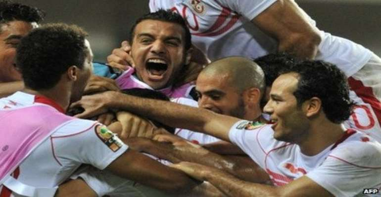 Tunisia's players celebrate a massive opening win over neighbours Morocco