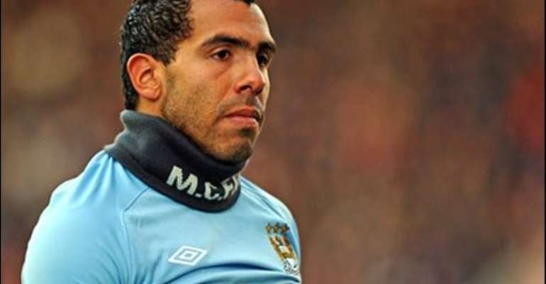 Carlos Tevez would be sued if he lays down his boots