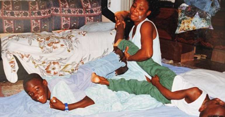 Young Balotelli playing with his biological mother and brother