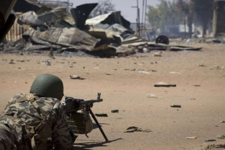 <b>A Malian soldier holds position in front of the courthouse in Gao on February 22, 2013.  By Joel Saget (AFP)</b>