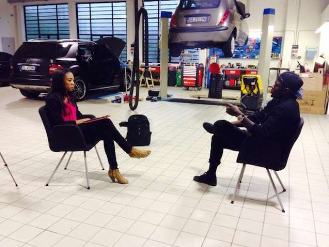 Sports Journalist Juliet Bawuah interviews Sulley Muntari @ his car 4FK motor company