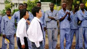 New colonialism: African workers waiting for the orders of new colonial masters, the Chinese