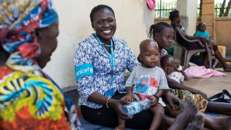 Unicef nutrition expert Jesca Wude Murye plays with the boy at Al Sabbah Hospital.