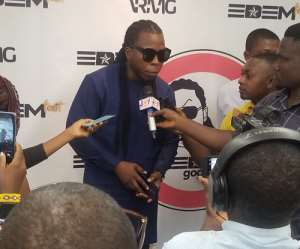 Edem addressing the media after the launch