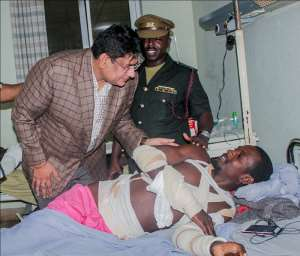 Mr. Vishal Dogra of the Conserveria Distribution (Gino Brands) With A Victim Of The Gas Explosion At The 37 Military Hospital