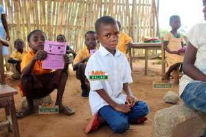 Another Case Of Poor Infrastructure: Pupils Of Tapa Amanya Learn On Stones