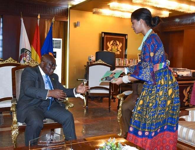 President Akuffo-Addo receiving book on Zuriel