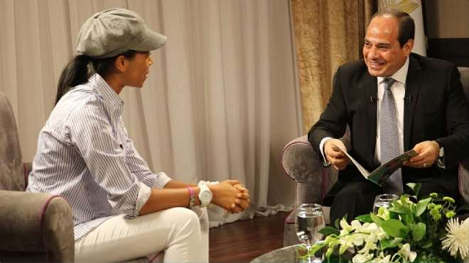 Zuriel Presents Book To President El Sisi