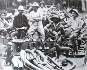 British soldiers of the infamous Punitive Expedition of 1897 proudly posing with looted Benin artefacts.