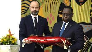 French Prime Minister Edouard Philippe symbolically handing over to Senegalese President Macky Sall the sword of Omar Saïdou Tall, who led resistance against the French in 1857-1859.