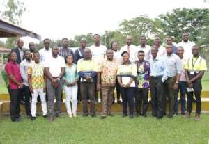 Nana Ampofo-Bekoe in a group photograph with the facilitator and journalists